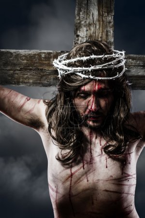 Jesus Christ with crown of thorns white on the cross of Calvary