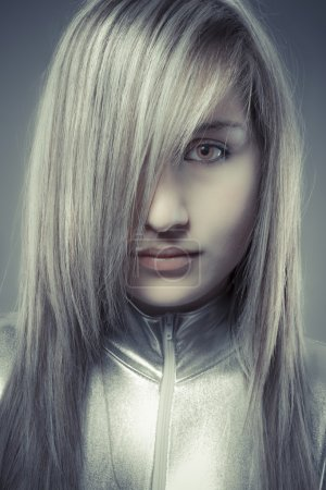 Serious young blond, concept future and modernity, girl with swe
