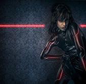 Sexy brunette in black latex costume , science fiction scene, fa