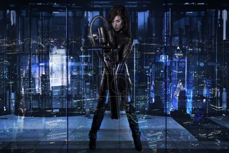 Future woman dressed in black latex with a huge gun