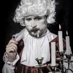 Gentleman rococo era wig, chandelier with candles...