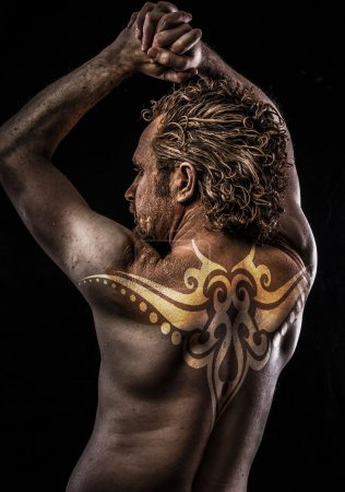 Male model with tribal tattoo on his back...