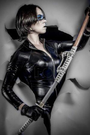 Woman dressed in black latex