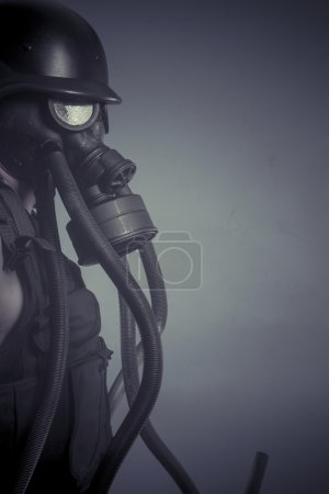 Man with black gas mask