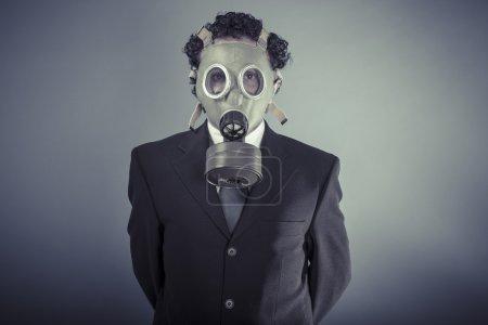 Business man wearing a gask mask