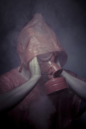 Man with red mask and plastic suit