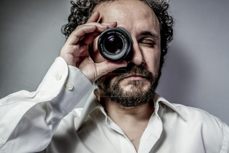 Photographer with lens