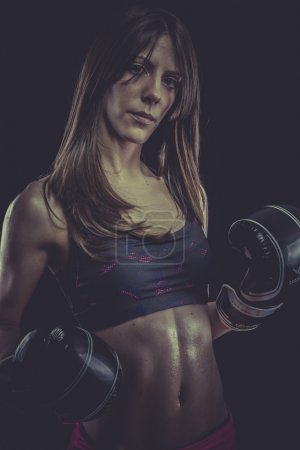 Female Athlete with boxing gloves