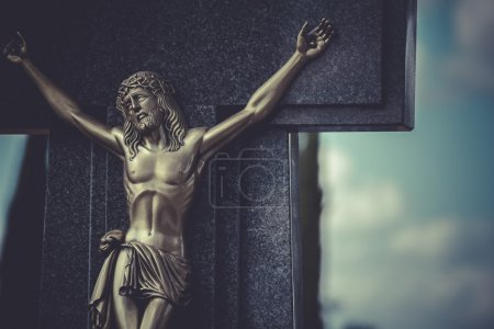 Jesus Christ on the cross in a cemetery