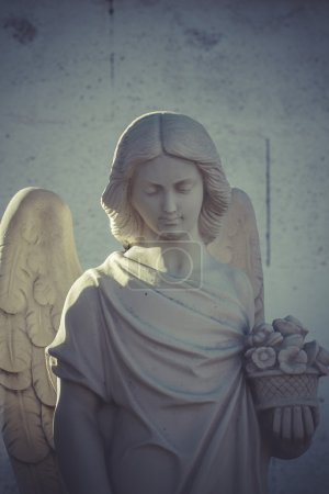beautiful stone angel on a cemetery