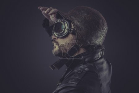 Pilot dressed in vintage style leather cap