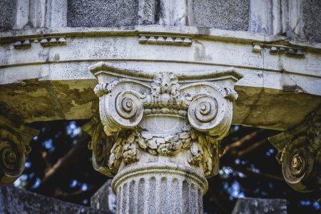 Corinthian capitals in a park