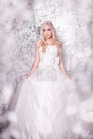 Beautiful blond bride portrait in studio