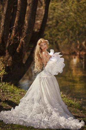 Blond bride in white