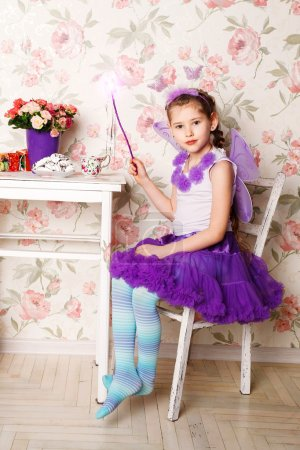 Portrait of a beautiful baby girl wearing a pink ballet tutu