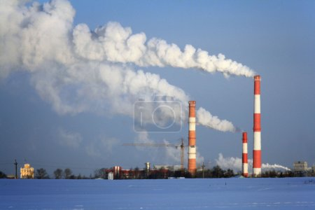 Pipe with smoke, urban landscape in winter, the environment, glo