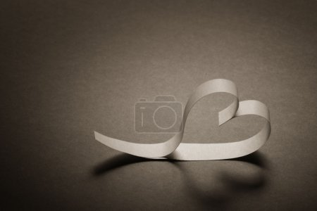 heart of white paper on a gray background background on Valentines Day