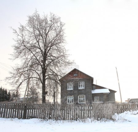 wooden house on a cold winter