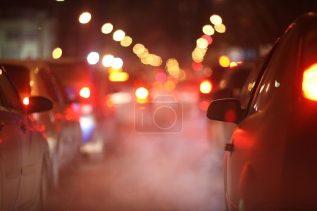 Photo for Cars at night in a traffic jam in winter frost - Royalty Free Image