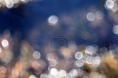 Blurred blue water reflections. Bokeh