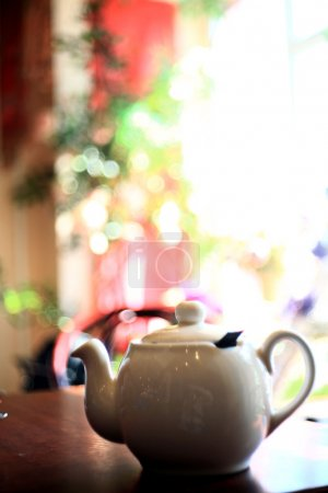 Teapot closeup with colored blurred background