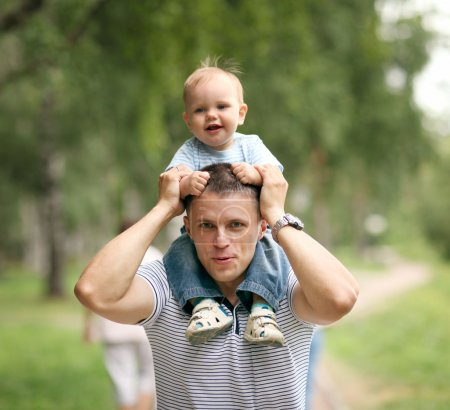 Photo for Little boy playing in the park with dad - Royalty Free Image