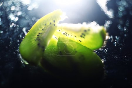 Photo for Fresh kiwi slices on black - Royalty Free Image