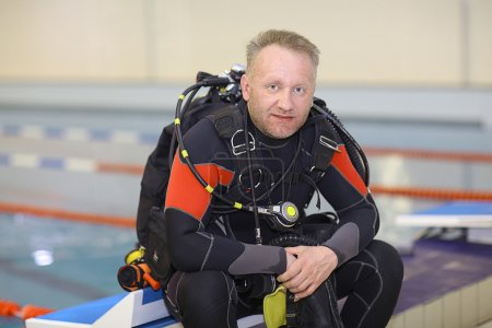 Diver in  swimming pool