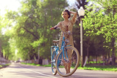 Girl with bicycle in park