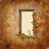 Dřevěný rám na podzimní pozadí