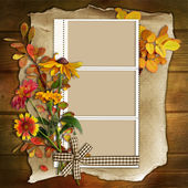 Frame with flowers on a wooden background