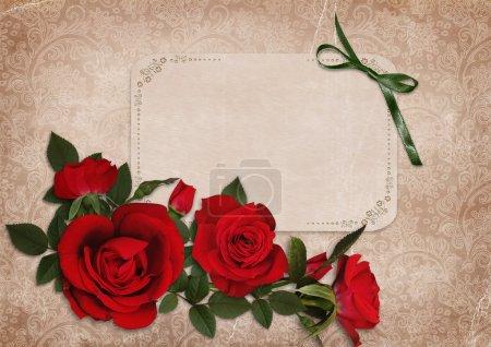 Photo pour Roses rouges avec une carte avec espace pour le texte sur fond vintage - image libre de droit
