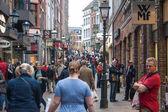 People walk on a street in Aachen