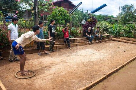 locals play petanque in Laos