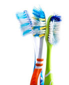 Old used colorful toothbrushes
