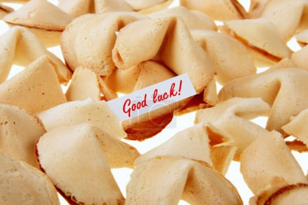 Photo for GOOD LUCK! - backlit fortune cookies over white - Royalty Free Image