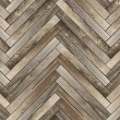 Pattern of old wood tiles forming parquet floor...