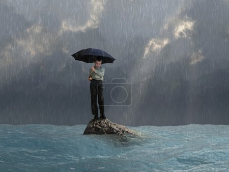 Photo for Man with an umbrella in the flood - Royalty Free Image