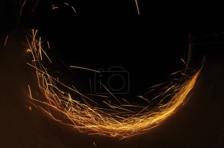 Metal sawing. Hot sparks at grinding steel material.
