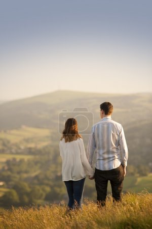 Young couple in beautiful landscape