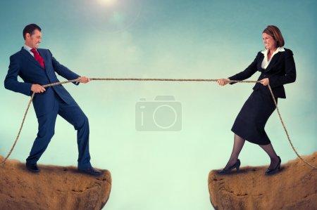 Man and woman tug of war