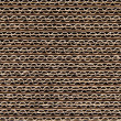 Repeating corrugated cardboard background texture....