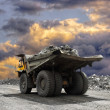 Heavy mining truck driving along the opencast...