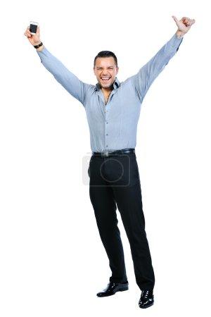 Foto de Cuerpo de joven gesticular feliz sonriente a hombre de negocios con el teléfono móvil, aislado sobre fondo blanco - Imagen libre de derechos