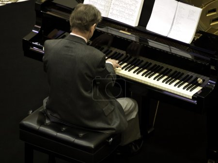 Senior man playing the piano