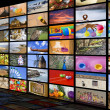 Big TV videowall with different channels in a blac...