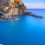 Manarola town on cliff rocks and sea at sunset., S...