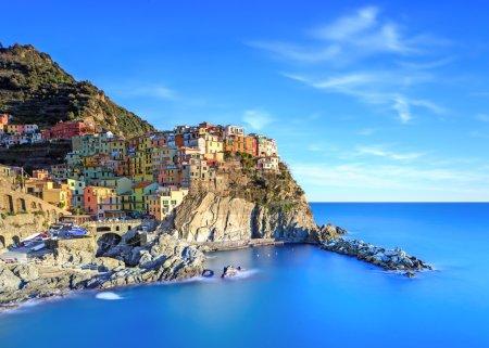 Manarola village, rocks and sea at sunset. Cinque Terre, Italy