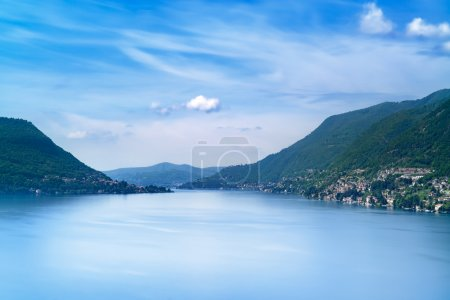 Como Lake landscape. Cernobbio village, trees, water and mountains. Italy