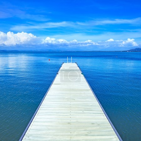 Wooden pier or jetty on a blue ocean. Beach in Argentario, Tuscany, Italy